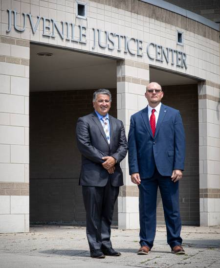 Auciello and Evans in front of Juvenile Justice Center